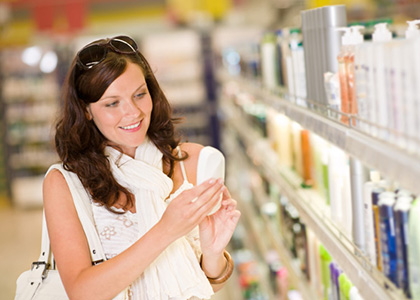 Woman shopping for disposable wipes