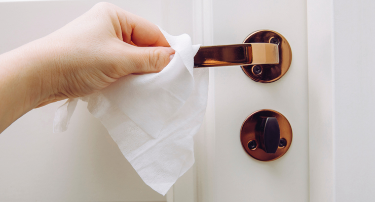 disinfecting wipes to clean the door knob